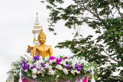 Golden buddha image parade in festival Stock Photo