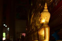 The golden Buddha image. Reverence in Buddhist sutras At Wat Luang Pothit, Thailand Royalty Free Stock Photography