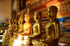 The golden Buddha image. Reverence in Buddhist sutras At Wat Luang Pothit, Thailand Royalty Free Stock Image