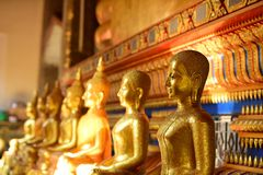 The golden Buddha image. Reverence in Buddhist sutras At Wat Luang Pothit, Thailand Stock Photo
