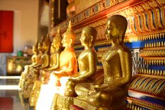 The golden Buddha image. Reverence in Buddhist sutras At Wat Luang Pothit, Thailand Stock Image
