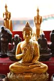 Golden Buddha image in sitting posture Royalty Free Stock Photography