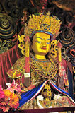 Golden Buddha images. Clay sculptured image of buddha with gold in Gandan Monastery of Gelug Sect, Tibetan buddhism, lhasa Royalty Free Stock Images