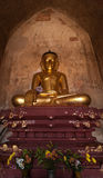 Golden Buddha inside one of pagoda ruins at Bagan, Myanmar (Burma) Royalty Free Stock Photo