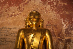 Golden Buddha inside one of pagoda ruins at Bagan, Myanmar (Burma) Stock Image