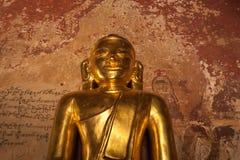 Golden Buddha inside one of pagoda ruins at Bagan, Myanmar (Burma) Stock Image