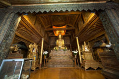 Golden Buddha inside at wood Church of Nyan Shwe Kgua temple. Stock Photography