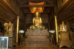 Golden Buddha inside at wood Church of Nyan Shwe Kgua temple. Stock Image