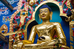 Golden Buddha. A large gilded deity of Gautama Buddha stock images