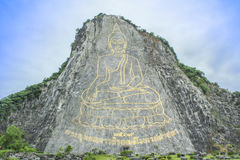 Golden Buddha laser carved and inlayed with gold on Khao Chi Cha. N Cliff, Pattaya, Chonburi, Thailand,Buddha Mountain Royalty Free Stock Images