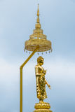 The golden Buddha on the light blue sky. The golden Buddha on the light blue sky is so beautiful view Stock Image