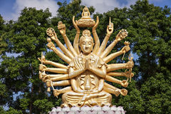 Golden buddha with many arms Royalty Free Stock Images