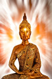 Golden Buddha meditating Stock Photo