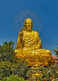 Golden Buddha statue sitting lotus Happy Bodhi day. Golden Buddha Meditating sitting lotus in buddhist temple. Buddhist holiday - Happy Bodhi day achieved stock photos