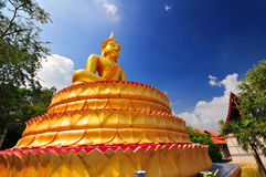 The golden Buddha in Meditation on lotus base Royalty Free Stock Photo