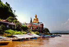 Golden Buddha on the Mekong River, Sop Ruak, Thailand. Gorgeous Asian landscape. Royalty Free Stock Photo