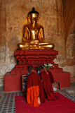 Golden buddha with monks praying Royalty Free Stock Photo