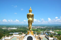 Golden buddha on mountain with blue sky at Wat Phra That Kao Noi Royalty Free Stock Image