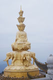 The golden buddha of mt emei. The golden buddha on summit top of mount emei in sichuan, china Royalty Free Stock Image