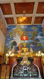 Golden Buddha in painted chapel Stock Images