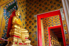 Golden Buddha in pavilion. Golden Buddha on painting wall in pavilion at temple, Bangkok, Thailand stock image
