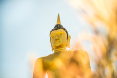The Golden Buddha at Phu salao temple overlooking the Mekong river and the city of Pakse. Stock Images