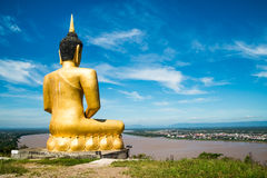 The Golden Buddha at Phu salao temple overlooking the Mekong river. Royalty Free Stock Photos