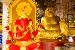 Golden Buddha and red Ganesha in Tiger Cave Temple, Wat Tham Suea, Thailand. Golden Buddha and red Ganesha in Tiger Cave Temple, Wat Tham Suea in Thailand royalty free stock photography