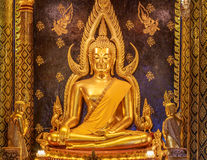 Golden Buddha's image. Phra phuttha chinnarat is one of the most beautiful buddha image. This buddha image located in a public temple called Wat Phra Sri Rattana Royalty Free Stock Photos