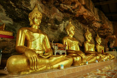 Golden buddha sculpture in cave. From thailand Stock Photography