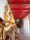 Golden Buddha sculpture in lotus position sitting Royalty Free Stock Photography