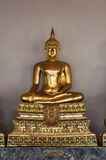 Golden Buddha sculpture in Wat Pho Stock Photography