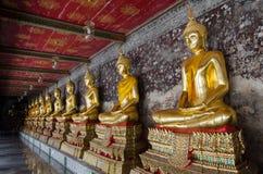 Golden Buddha Sculptures Around Veranda. The golden Buddha sculptures was built in primary Ratthanakohsin era and stay around veranda of great church, Bangkok Royalty Free Stock Image