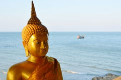 Golden Buddha at the sea Royalty Free Stock Photos