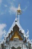 Golden Buddha on silver church Stock Photography