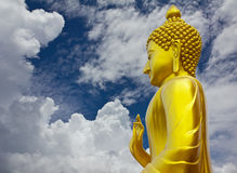 Golden Buddha in sky and cloudy. Stock Images