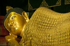 Golden buddha in sleeping posture Royalty Free Stock Photography