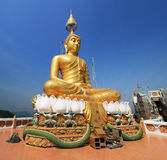 Golden buddha statue. Wat Tham Seua or Tiger Cave Temple mountain top golden Buddha statue, Krabi, Thailand Royalty Free Stock Photos