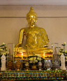 Golden buddha statue. With altar for worship Stock Photos