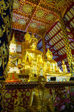 Golden buddha statue and angel statue Royalty Free Stock Photography