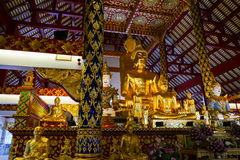 Golden buddha statue and angel statue Stock Photos