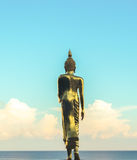 Golden Buddha Statue from Back with Blue Sky and Blue Sea, Evening Shot Royalty Free Stock Photo