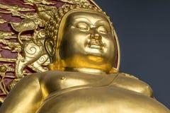 Golden Buddha statue at Bangkok Thailand temple. Gold statue at Bangkok Thailand Buddhist temple Royalty Free Stock Images