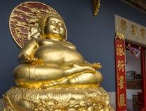 Golden Buddha statue at Bangkok Thailand temple. Gold statue at Bangkok Thailand Buddhist temple Stock Photography