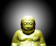 Golden buddha statue in black background Stock Photo