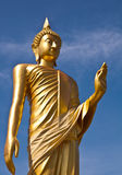 Golden buddha statue with blue sky background. At thai temple Royalty Free Stock Images