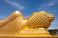 Golden buddha statue with blue sky background. At thai temple Royalty Free Stock Photography