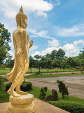 Golden buddha statue. Golden buddha statue with blue sky background Royalty Free Stock Photography