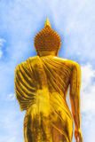 Golden Buddha Statue and blue sky in thai temple Royalty Free Stock Photography