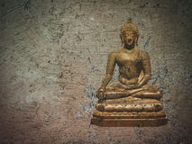 Golden buddha statue on brown crack earth Stock Photos